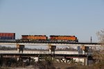 BNSF 8104 Leads a EB stack train over the Kct bridge.