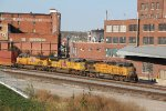 UP 6397 Leads a EB stack train into the West bottoms.