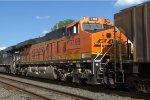 BNSF ES44C4 7198 trails on H68