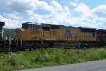 UP SD70M 4995 trails on H68