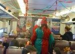 Santa and Elf make their way through