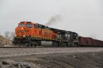 BNSF 796 Leads a rock train into the siding.