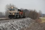 BNSF 9811 a Cream n Green mac on the lead of a empty coal.