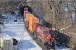 Eastbound intermodal pops out of tunnel