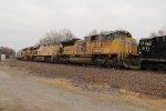 UP 8388 Heads a Sb grain train past a EB freight train..