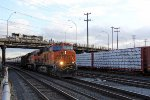 BNSF 7871 and BNSF 7543 pull an oil train through Argo Yard