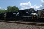 NS SD70ACe 1043 trails on 591