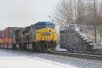CSX 5007 leads a doublestack westbound at the old Westshore overpass abutments