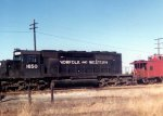 NW SD40-2 1650 and a caboose