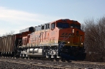 BNSF 5876 leans into the curve with coal loads eastbound