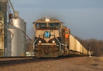 BNSF 9494 heads west into the sun with empties