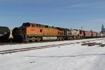 BNSF 5280 Leads a NB grain train past a tied down local in Old Monroe Mo.