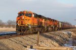 BNSF 7094 Brings a grain train into the setting Sun.
