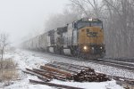 CSX 8738 and KCSM 4559 lead this freight into the Snow storm.