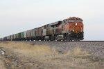 BNSF 7080 Leads a empty grain train east..