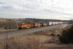 BNSF 8187 Leads a EB stack train up hill at Hart Mo.
