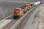 BNSF 7228 Screams west with a freight train in tow.