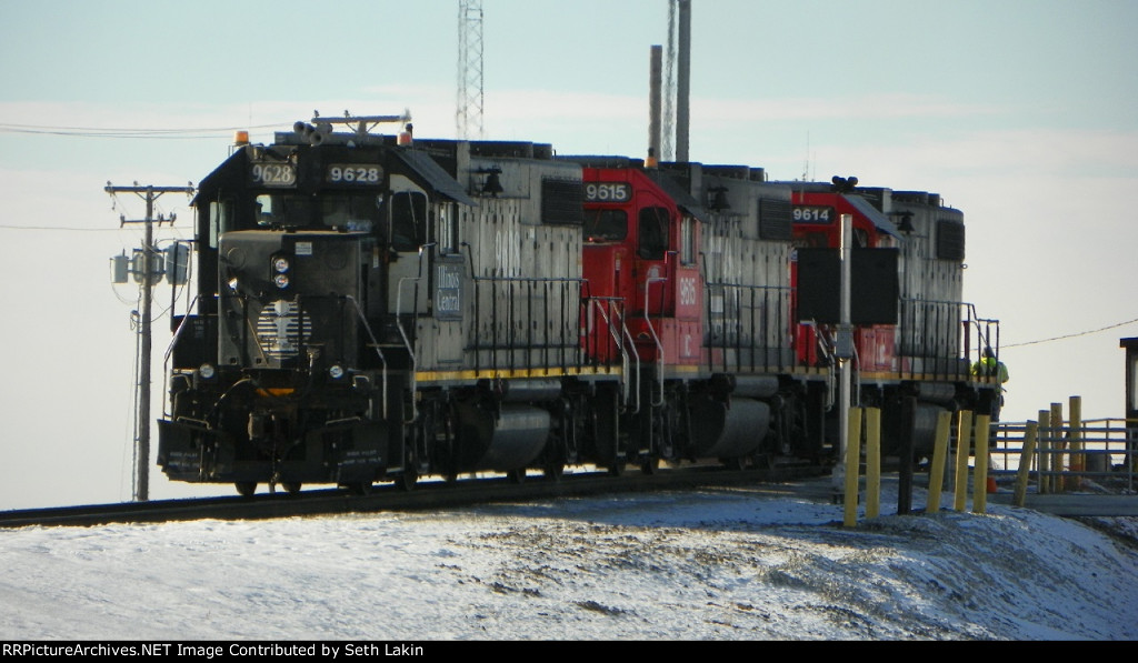 IC 9628 and two other GP38's crest the hump