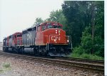 CN 5271 with a CN trackage rights train on the BN