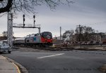 A nice catch under the soon to be retired Southern Signal tower while the new one is being built.  Amtrak 16 sporting a Phase I heritage paint