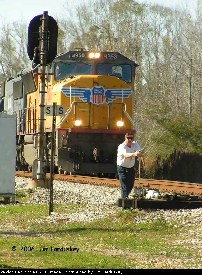 After stopping for the red signal, Conductor Enfinger cycles the spring switch trying to clear the signal.  Notice the homemade number board on fireman's side.