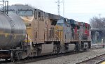 Three locomotives, CN, CSX and UP