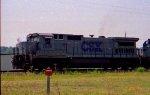 CSX 7585 leads a train towards the yard