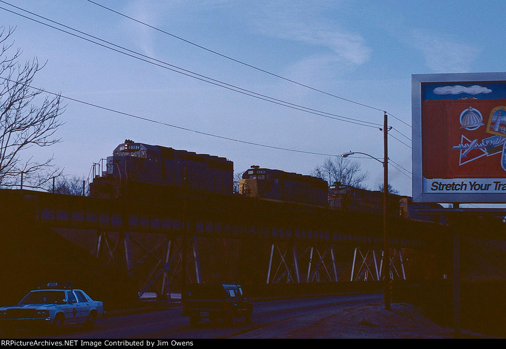 A CSX eastbound leaves Laurens across the old CN&L bridge in downtown. This bridge was dismantled soon after the bypass line was built around Laurens..
