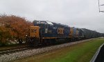 CSX 6471 & 2259 lead a string of empty woodchip hoppers northbound
