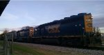 CSX 6034 & 6143 lead a string of loaded woodchip cars thru town