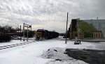 CSX 6143 kicks up some snow at a crossing as it heads thru town