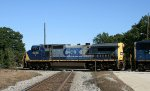 CSX 9035 leads train Q484 across the diamonds at Maple