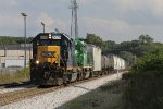 Westbound on Track 2, CSX 6079 leads D907-18 through GR