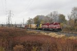 Just out of Hughart, the three SD40's of GDLK303 work hard to get the long train moving south