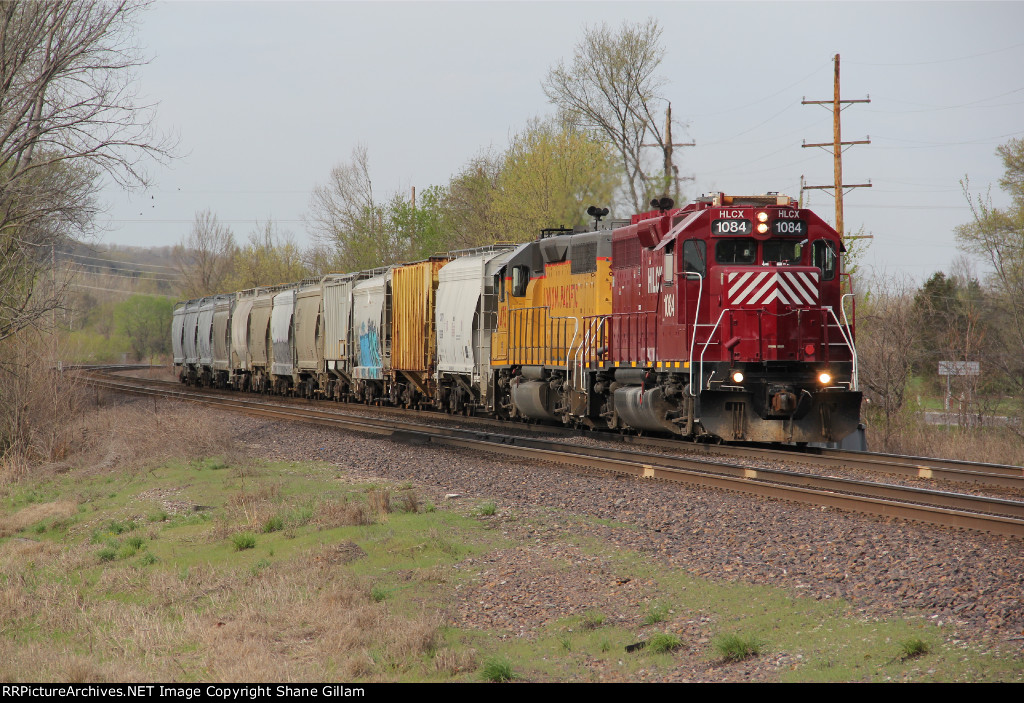HLCX 1084 Leads the Sand local east down the Jeff city Sub.