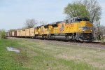 UP 8935 Brand new Ace heavy leads a freight train.