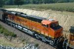 BNSF 5755, GEVO ES44AC, is eastbound with coal loads