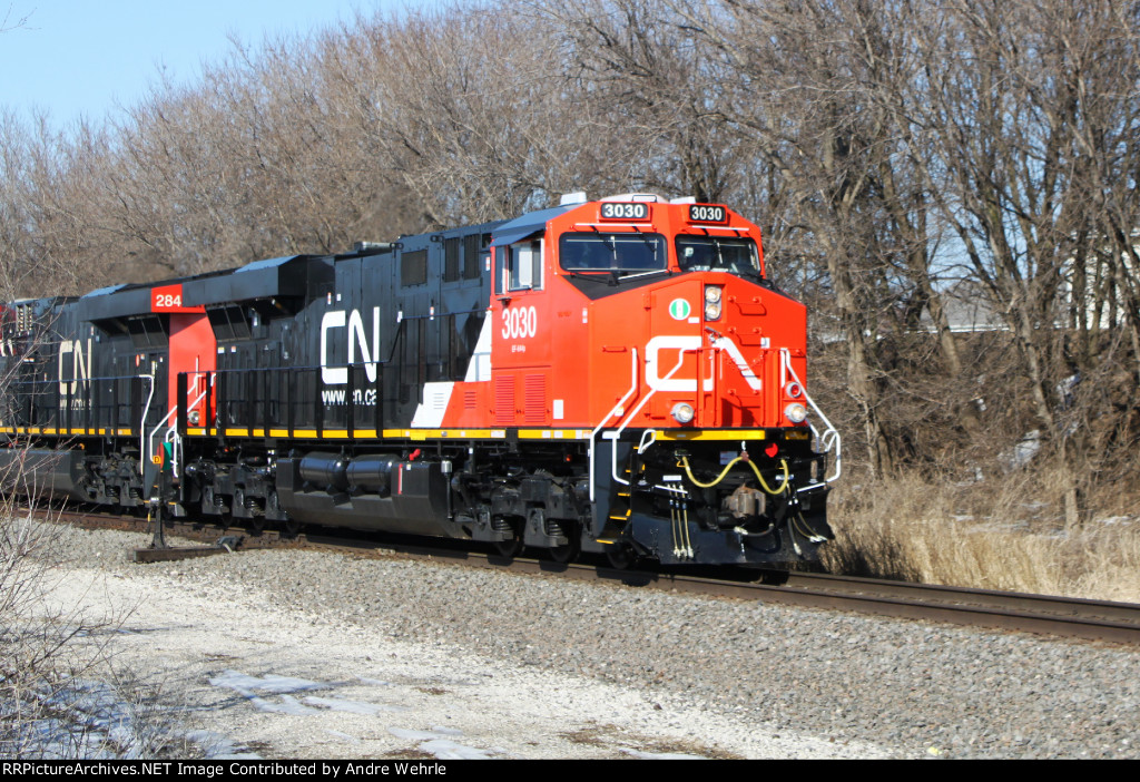 Brand spanking new CN 3030 leads a southbound manifest past Joseph Road