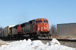 CN 5621 leads a southbound autorack train off the siding