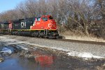 "CN 8937 leads another SB past the temporary ""reflecting pool"""