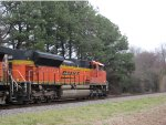 BNSF 9298 rolls past some pines