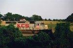 KCS 643 leads an NS train