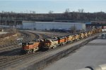 BNSF 1728 bringing a eastbound transfer past the dpu's of a ogex coal load  at santa fe jct