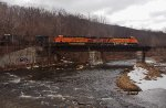 BNSF 5765 leads the eastbound grain train across the Hoosick River