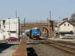 The Conrail Heritage Unit on the 66W passing the old Railroad House