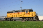 UP 1078 keeps the dandelions company in the spring morning sun at South Yard