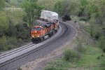 BNSF 5909 Leads a Q train around one of many sweeping curves.