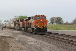 BNSF 7087 Roars east under a Santa Fe signal bridge.