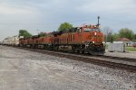 BNSF 6866 Leads a Stack train through town on main 2.