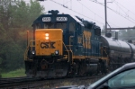 CSX GP-38-2 #2680 is on the rear of a local in the rain through the Passenger Station